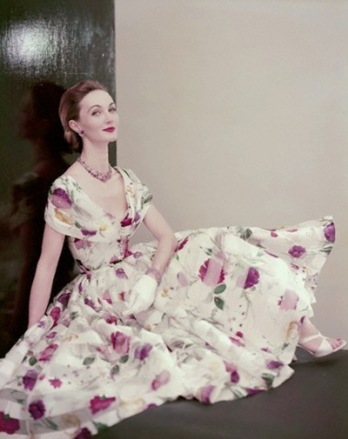 Model is wearing a dress of floral printed white silk organdy with a beaded necklace and bracelet of tourmalines and diamonds 1955_thumb[2]