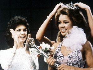 FILE - In this Sept. 17, 1983 file photo, Miss New York Vanessa Williams is crowned Miss America 1984 at the Miss America Pageant in Atlantic City, N.J. The Miss America Organization, Dick Clark Productions and the ABC television network announced Tuesday, Sept. 8, 2015, that they are bringing back the actress and singer to serve as head judge for the 2016 competition. Williams won the title in 1984 but resigned after Penthouse magazine published sexually explicit photographs of her taken several years earlier. (AP Photo, File)